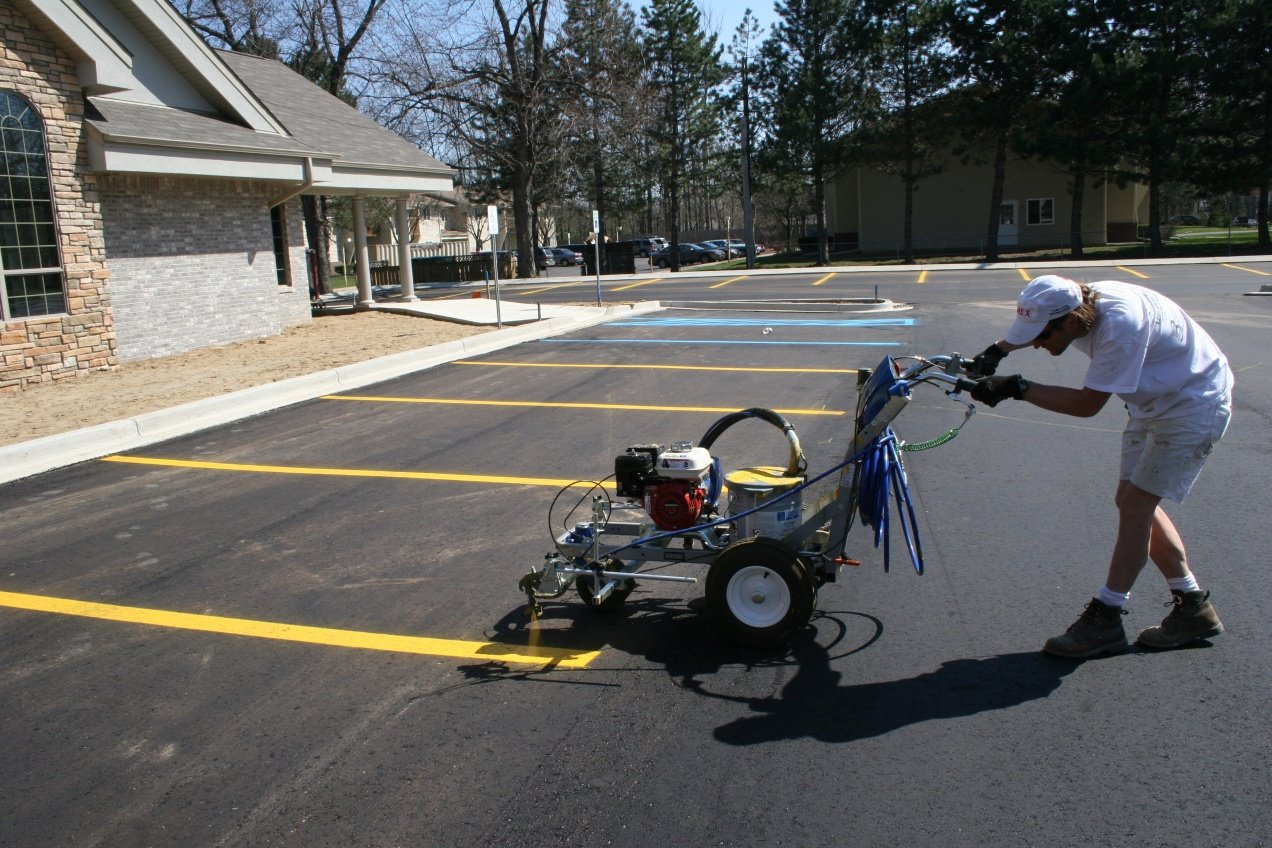 Parking lots and stripping service home construction and for Parking lot painting equipment
